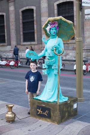the ramblas: Barcelona, Spain-May 27, 2013. Street performer on the famous Las Ramblas, early evening, Barcelona, Spain Editorial