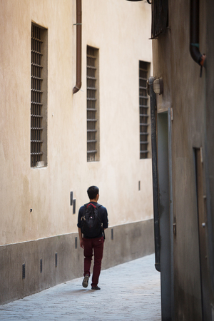 criss: Florence-Italy, June 12, 2015. View down one of the ancient alleys that criss cross Forence, Italy, with locals and tourists. Editorial