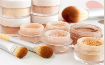 cosmetic brushes, make-up powder, blush, foundation, eyeshadow in plastic jars photo