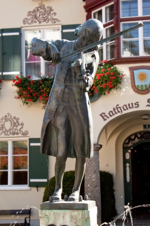 mozart: Mozart statue on the sqare near the townhall in St  Gilgen, Austria Editorial