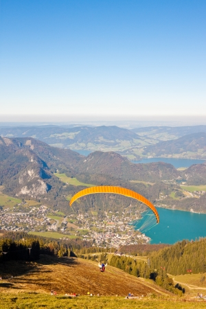 paragliding over mountains and  Wolfgangsee lake in austrian Alps photo