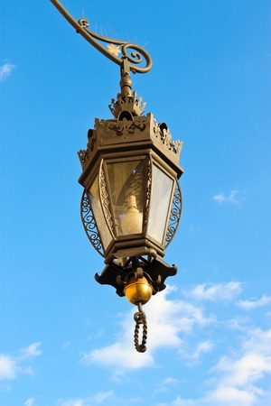 wrought-iron lantern  hanging with sky on the background photo