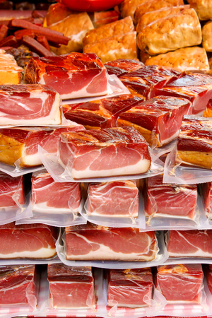 vacuum packed pieces of meat on a farmers market Stock Photo