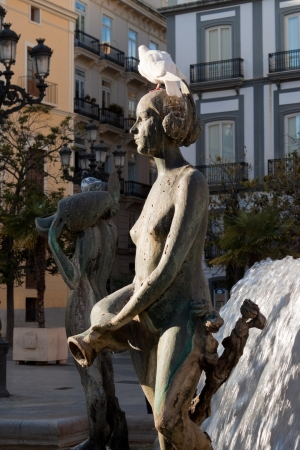 one of the sculptures of the Turia Fountain in Valencia, Spain photo