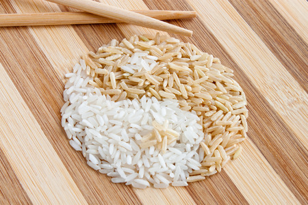 white and brown rice shaped as Yin Yang Symbol photo