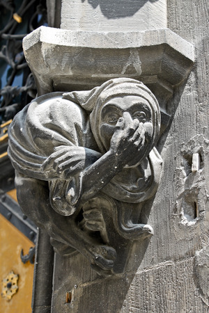 Giggling gargoyle as a decor element of the New Town Hall in Munich