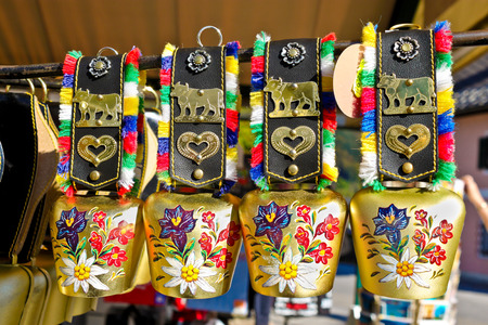 ST  GILGEN, AUSTRIA - OCTOBER 3, 2011  Ornate traditional cow bells for sale in a souvenir shop in St  Gilgen