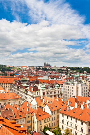 High up view of Prague with St  Vitus cathedral in the distance