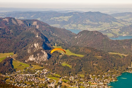 paragliding over mountains, St  Gilgen and  Wolfgangsee lake in austrian Alps