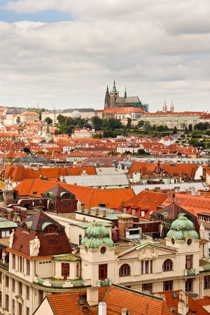 High up view of Prague rooftops  with St  Vitus cathedral in the distance Imagens