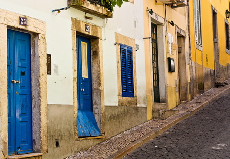 old doors  of the house on the street going uphill in Lisbon, Portugal