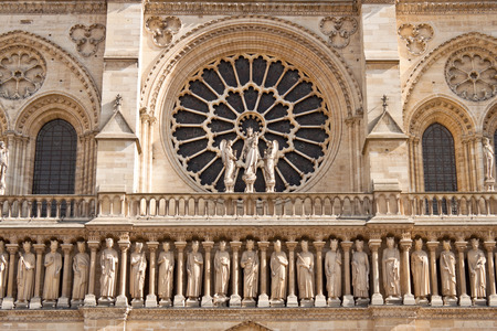Closeup view of the Notre Dame de Paris Cathedral facade with kings photo