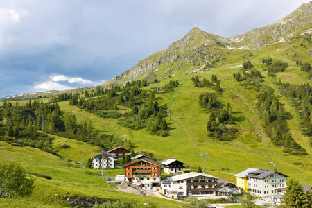 OBERTAUERN, AUSTRIA - JULY 2  Hotels and guesthouses at the resort in austrian Alps on July 2, 2013  Austria is famous for recreational mountain resorts