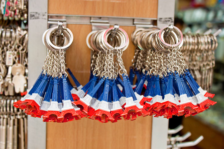 PARIS - SEPTEMBER 21  Key rings shaped as the most famous french landmark, Eiffel tower, in colors of the french flag in a souvenir shop on September 21, 2013 in Paris, France  Editorial