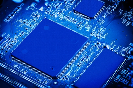 Close up detail of blue microchip circuit board