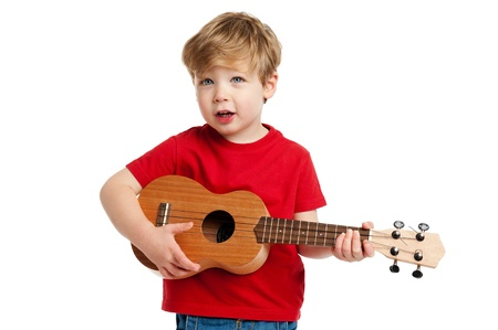 Boy singing and playing guitar shot in the studio on a white background  Standard-Bild
