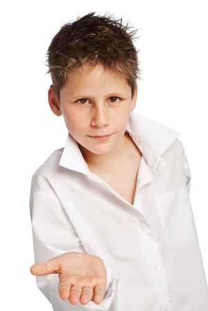 begging: Young boy with hand out open and flat  Stuio shot on white background  Stock Photo