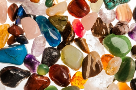 Assortment of polished semi-precious gem stones shot in the studio against white background  photo