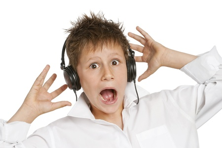 Boy with headphones, shocked and startled by loud noise photo
