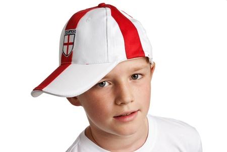 Boy wearing England Football Cap. Studio on white background.