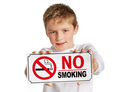 Boy with no smoking sign on white background. Studio white background.