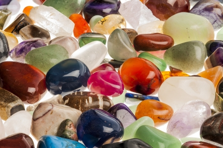 Assortment of polished semi-precious gem stones shot in the studio against white background