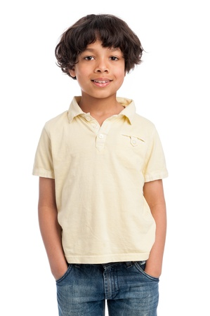 Cute casual mixed race afro caribbean boy standing isolated in studio white background and yellow tee shirt. photo