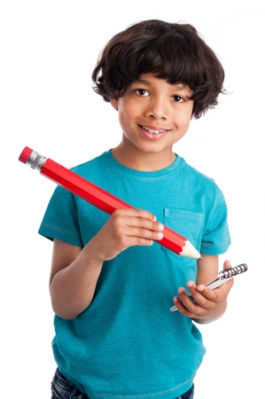 Cute mixed race boy with big pencil isolated on white background. Standard-Bild