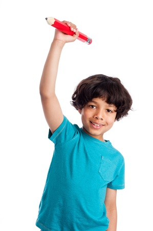 kids writing: Cute mixed race boy throwing big pencil isolated on white background. Stock Photo