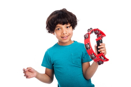 jamaican man: Cute mixed race kid playing a tambourine, isolated against white background. Stock Photo