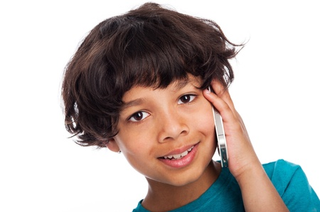 Cute afro carabean boy talking on mobile phone. Isolated on white studio background. photo