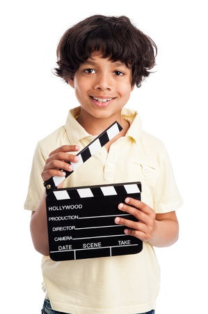 Mixed race boy smiing with film directors clapper board. Isolated on white background.