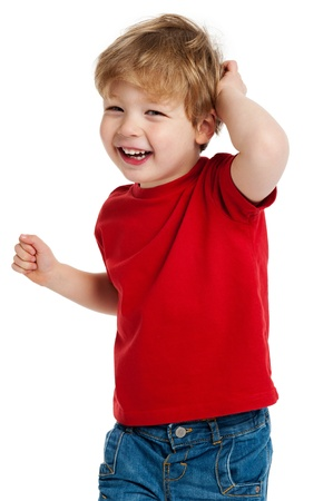 Smiling happy boy in red T shirt shot in the studio on a white background. Standard-Bild