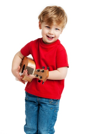 Boy singing and playing guitar shot in the studio on a white background.