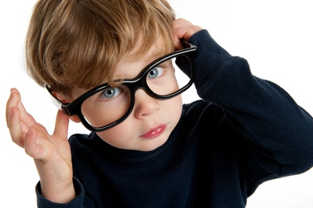 funny glasses: Funny little boy with big glasses shot in the studio on a white background.