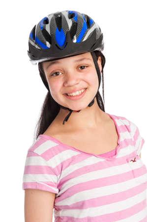 headgear: Teenage girl wearing a bicycle helmet Stock Photo