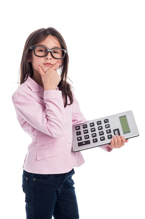summation: Clever girl with glasses and a calculator doing a calculation. Isolated on a studio white background. Stock Photo