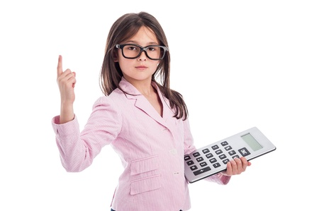 young add: Young girl counting a calculator and holding up one finger. Isolated on white background.