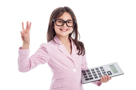 Young girl counting a calculator and holding up three fingers. Isolated on white background.