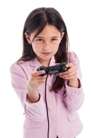Young girl with games controller looking intently at camera with serious but happy expression. Isolated on white studio background.