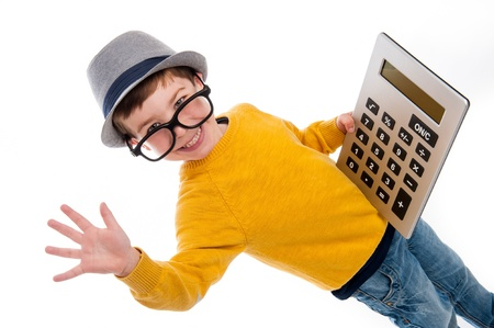 Geeky toddler boy with big calculator, big glasses and wearing a hat. Studio shot isolated on white. Archivio Fotografico