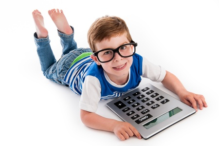 big foot: Geeky toddler boy lying on the floor with big calculator and big geeky glasses. Studio shot isolated on white.