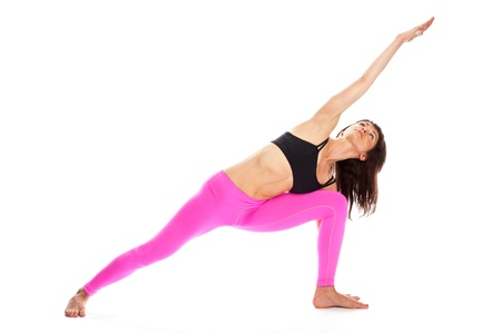 Pretty woman in rextended side angle yoga pose. Isolated on white studio background.