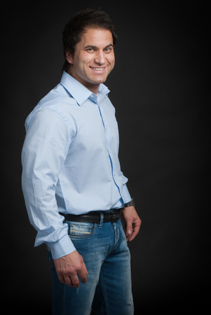 turkish people: Portrait of Mediterranean man in jeans and blue shirt.