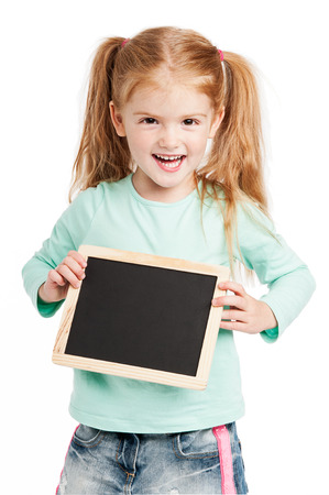 Funny girl holding chalkboard. Studio on white background. photo