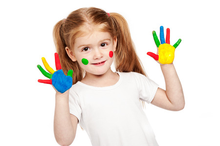 Toddler girl with brightly painted hands. Isolated on white background.