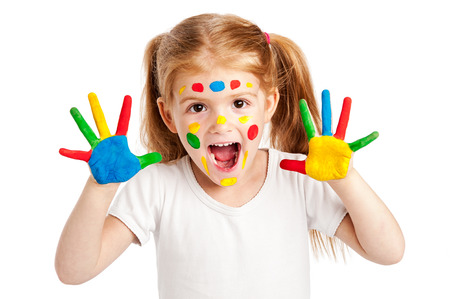 Funny young girl with brightly painted hands. Isolated on white background. Standard-Bild