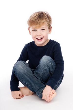 Happy boy shot in studio, isolated on white background. Standard-Bild