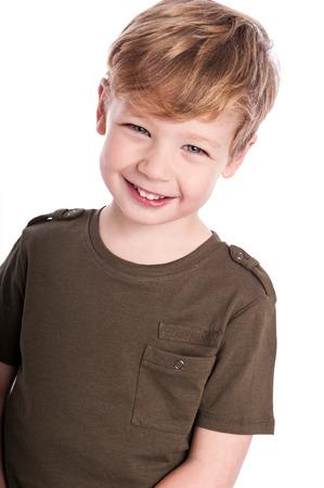 Gorgeous little boy. Studio on white background.