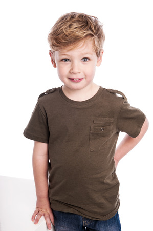 Cute gorgeous boy standing on studio white background.